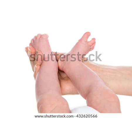 New born infant baby feet in mother hands. Mom and Child. Healthy medical concept. - stock photo