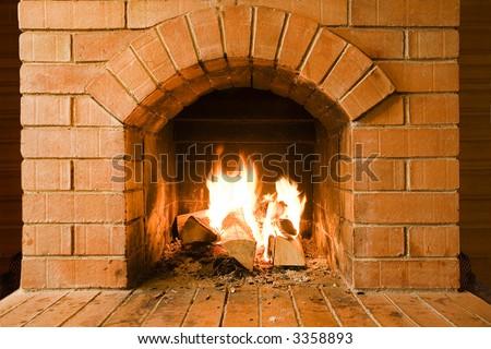 new brick fireplace - stock photo