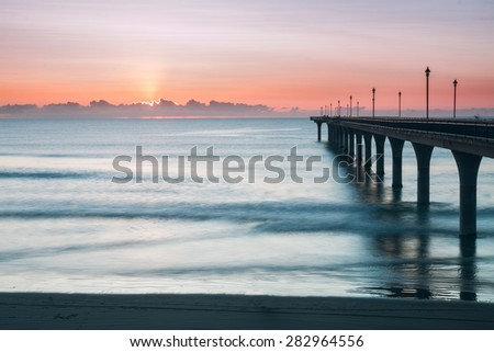 New Brighton Pier at sunrise, Christchurch, New Zealand - stock photo