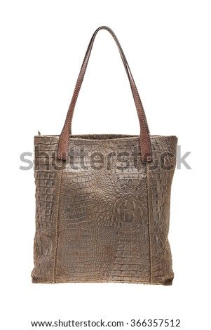 New Brown womens bag with crocodile texture isolated on white background. - stock photo