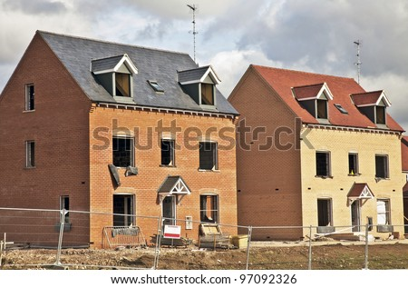 New build social and private housing under construction in a rural part of the UK - stock photo