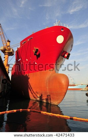New building tanker in shipyard with cranes on background - stock photo