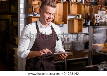 New business owner working on tablet - stock photo