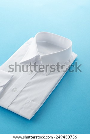 new business shirt on blue background - stock photo