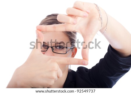 New business vision concept, businesswoman framing her face, isolated on white background. - stock photo