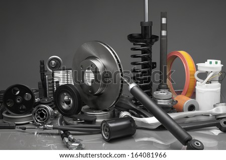 New car parts on a gray background - stock photo