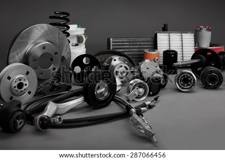 New car parts on a gray background closeup. Shop for auto. The composition of the new auto parts - stock photo