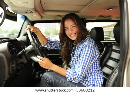 new car: woman driving her new bulletproof truck - stock photo