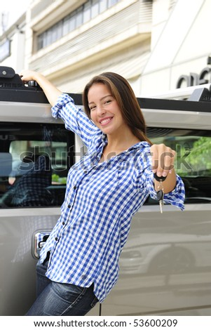 new car: woman showing keys of her new bulletproof car - stock photo