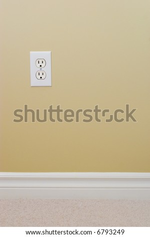 New carpet, wall and power outlet - stock photo