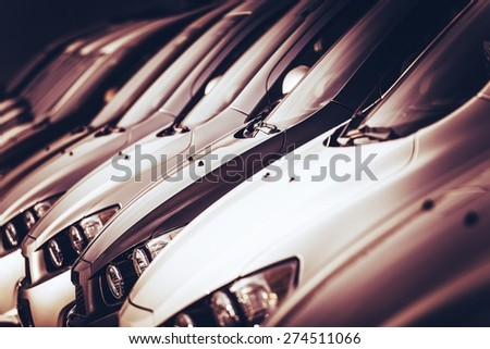 New Cars For Sale in a Row Closeup Photo. Car Dealer Lot. - stock photo