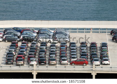 New cars parked at port - stock photo