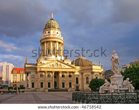 New Church (Deutscher Dom or German Cathedral) on Gendarmenmarkt, with the monument of Friedrich Schiller in the foreground. Berlin, Germany - stock photo
