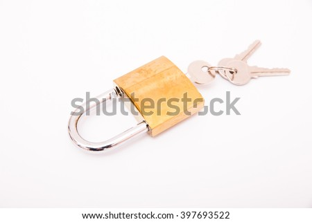 New close metal padlock with keys isolated on white background - stock photo