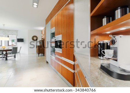 New coffee machine in elegant contemporary kitchen - stock photo