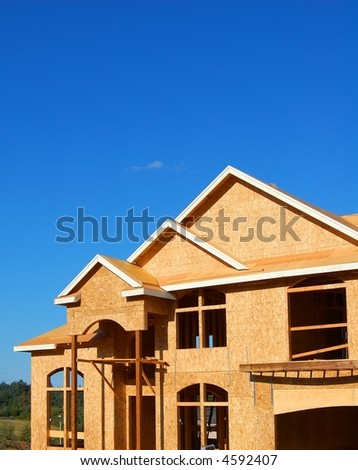 New Construction: Home Being Constructed on Beautiful Day - stock photo