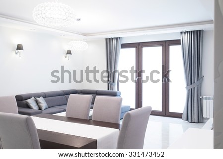 New contemporary designed living room with dining table