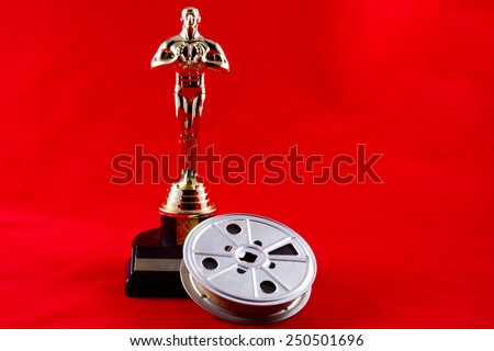 New Cumberland, PA, USA - February 3, 2015 : Oscar statuette with movie reel on red carpet - stock photo