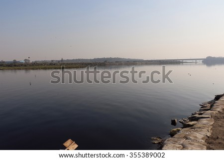 New Delhi, India - December 26, 2015: Yamuna river near ITO Bridge in New Delhi. Due to heavy domestic and industrial garbage the river transformed into a dirty stream of heavy polluted water.