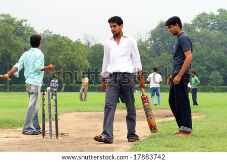 NEW DELHI, INDIA - 16 July: A group of university students in New Delhi during training at the cricket on July 16, 2008. - stock photo