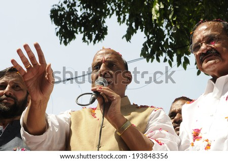 NEW DELHI-MAY 16:  BJP party president Rajnath Singh addressing supporters along with former president Venkaiah Naidu after they won the Indian National election on May 16, 2014 in New Delhi , India.  - stock photo