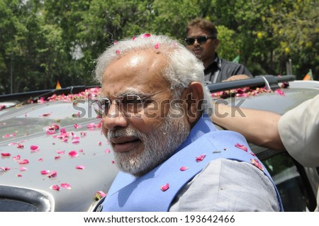 NEW DELHI-MAY 17: Indian Prime Minister Narendra Modi surrounded by his bodyguards during a roadshow  after wining the Indian National election on May 17, 2014 in New Delhi , India. - stock photo