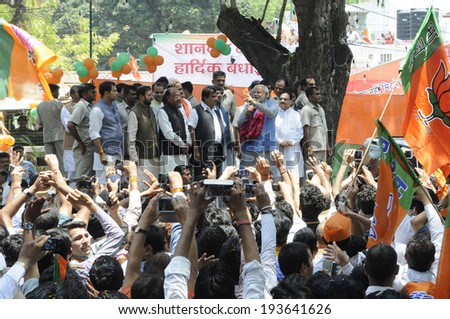 NEW DELHI-MAY 17: Narendra Modi along with other senior BJP leaders addressing their supporters after wining the Indian National election on May 17, 2014 in New Delhi , India.  - stock photo