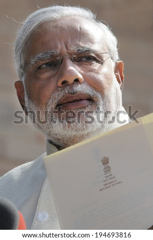 NEW DELHI-MAY 20:  Prime Minister Narendra Modi  reading out a document from President of India at Rashtrapati Bhavan during a press conference on May 20, 2014 in New Delhi , India.  - stock photo