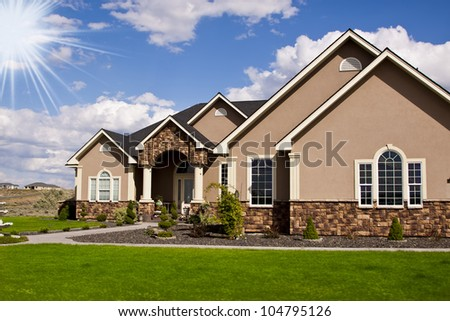 New detached single family luxury home with stone facade - stock photo