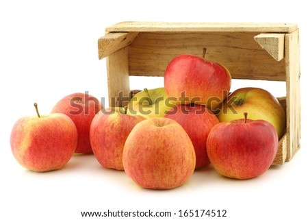 """New Dutch apple variety called """"Dalinco"""" in a wooden crate on a white background - stock photo"""