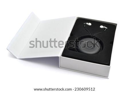 new earphones in box with case - stock photo