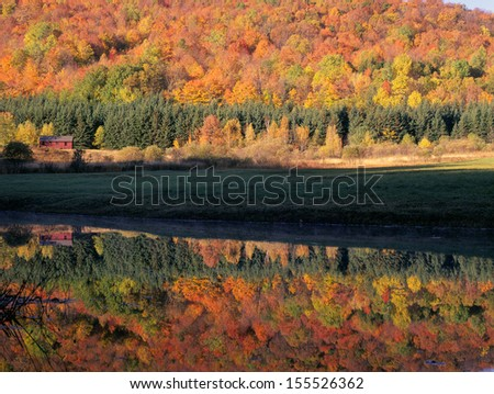 New England Autumn Mountains and Barn Reflection - stock photo