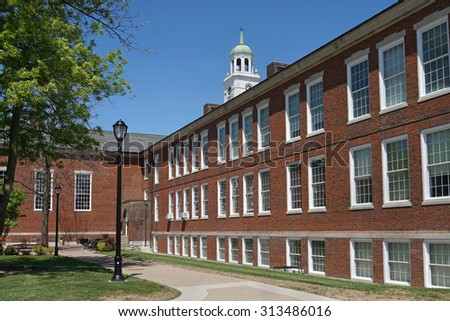 New England style brick college building with bell tower - stock photo