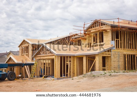 New family homes are under construction in a residential community.