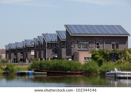 New family homes with solar panels - stock photo