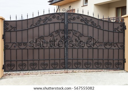 New forged metal double gates for entry of cars into the yard closed & Iron Gate Stock Images Royalty-Free Images \u0026 Vectors | Shutterstock Pezcame.Com
