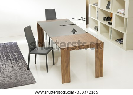 NEW FURNITURE LINE . MODERN DESIGN . STRAIGHT LINES . MATERIALS : WOOD ,  FABRIC . ITEMS : TABLE WITH CHAIR SET - stock photo