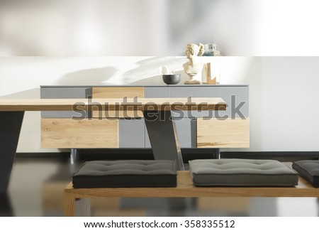 NEW FURNITURE LINE , MODERN DESIGN,  STRAIGHT LINES , MATERIALS : WOOD, METAL, FABRIC . ITEMS : TABLE , RECTANGLE BENCH, DRESSER - stock photo