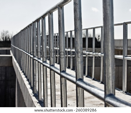 New galvanized fence at an industrial plant