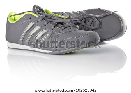 new grey sneakers isolated on white background - stock photo