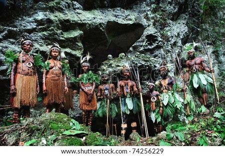 NEW GUINEA, INDONESIA - 2 FEBRUARY: The warriors of a Papuan tribe of Yafi in traditional clothes, ornaments and coloring. New Guinea Island, Indonesia. February 2, 2009. - stock photo