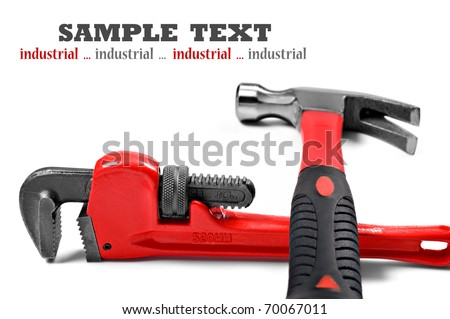 New hammer and wrench on a pure white background with space for text - shallow depth of field - stock photo
