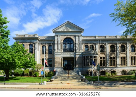 New Hampshire State Library Building was built in 1895 with native granite, in downtown Concord next to the State Capitol, State of New Hampshire, USA. - stock photo