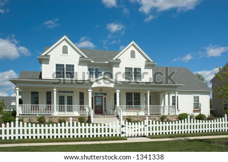 New home built in the tradition of the Colonial style with a country feel. Just one of many new house photos in my gallery. - stock photo
