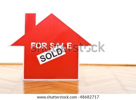 New home concept with house sold sign on the floor of an empty room