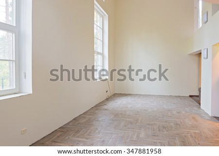 new home construction interior living room with unfinished tile wooden floors big windows and balcony - Big Tiles For Living Room
