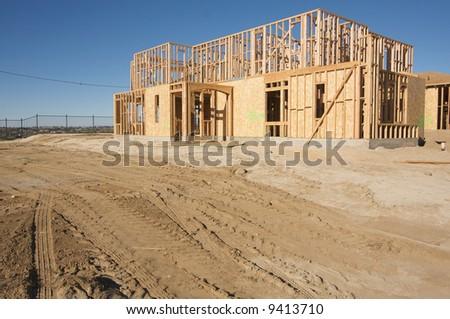 New Home Construction Site against a deep blue sky. - stock photo