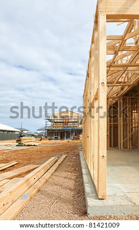 new home currently under construction against cloudy sky - stock photo