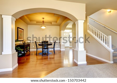 New home dining room interior with hardwood floors and table. - stock photo