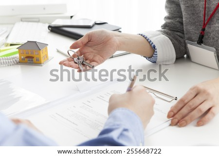 New home keys and house plan - stock photo